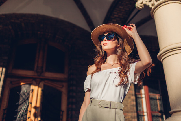 fashion-model-outdoor-portrait-tourist-woman-enjoying-sightseeing-lviv-girl-looking-ancient-atchitecture_106029-855