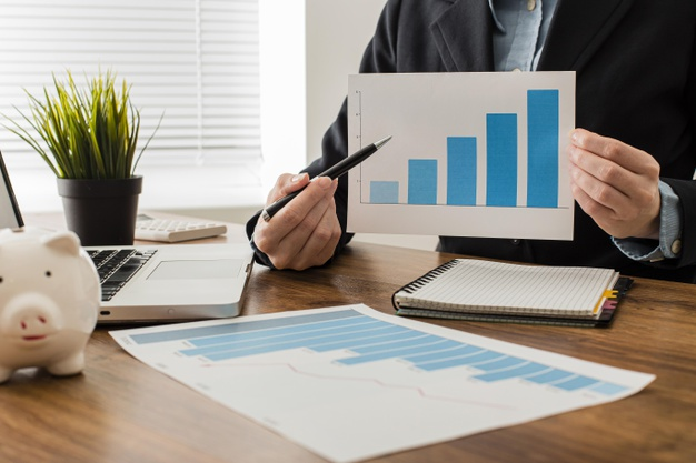 front-view-businessman-holding-growth-chart_23-2148780635