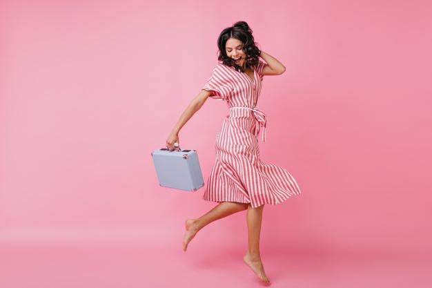slender-girl-great-mood-is-having-fun-dancing-with-bag-her-hands-shot-italian-model-wrap-dress_197531-9980